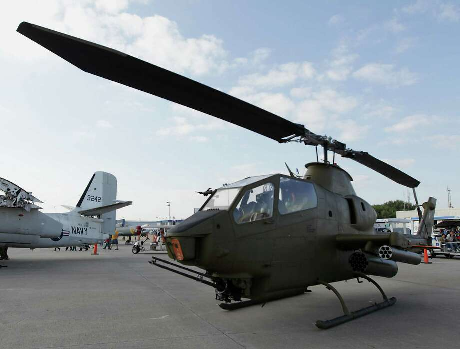 A Cobra helicopter on display during the Wings Over Houston Airshow at Ellington Airport Saturday, Oct. 26, 2013, in Houston. Photo: James Nielsen, Houston Chronicle / © 2013  Houston Chronicle