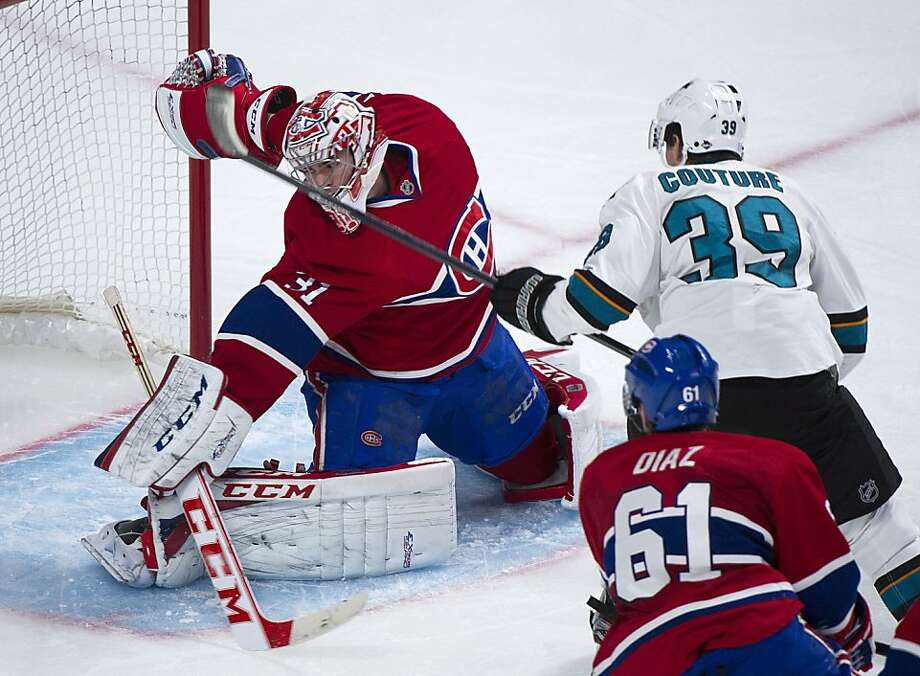 The Sharks' Logan Couture slips a shot past Canadiens goalie Carey Price for the game's first goal in the second period. Photo: Graham Hughes, Associated Press