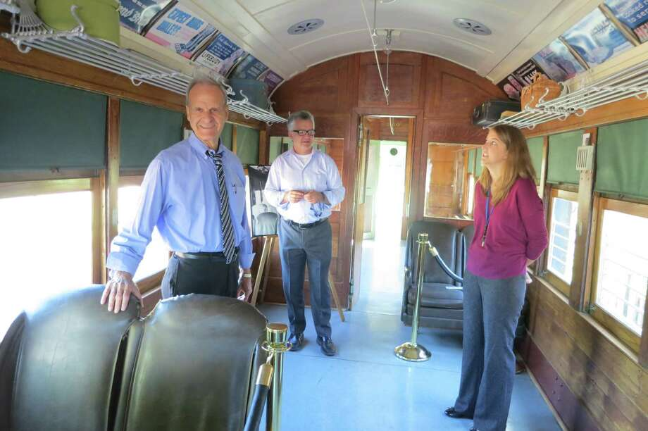 Russ Kissick, Jeff Campbell and Kirby Stokes of the Plano Conservancy lead a tour through Car 360, on display at the Interurban Museum in Plano. Photo: Joe Holley, Houston Chronicle / Houston Chronicle