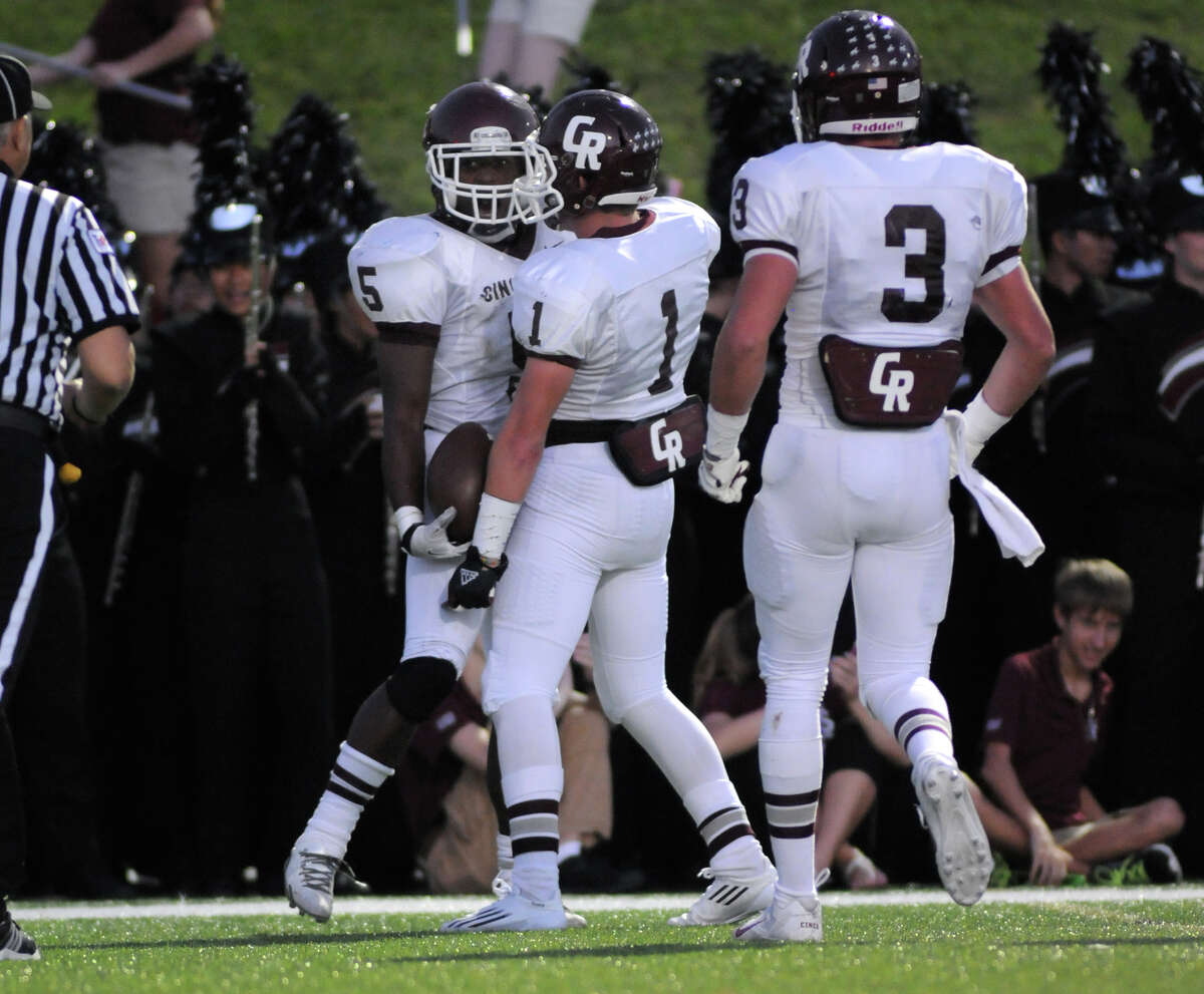 Cinco Ranch senior running back Denzell Bates (#5) celebrates his second quarter touchdown with teammates Geyrn Young (#1) during their district matchup at Rhodes Stadium in Katy on Saturday.