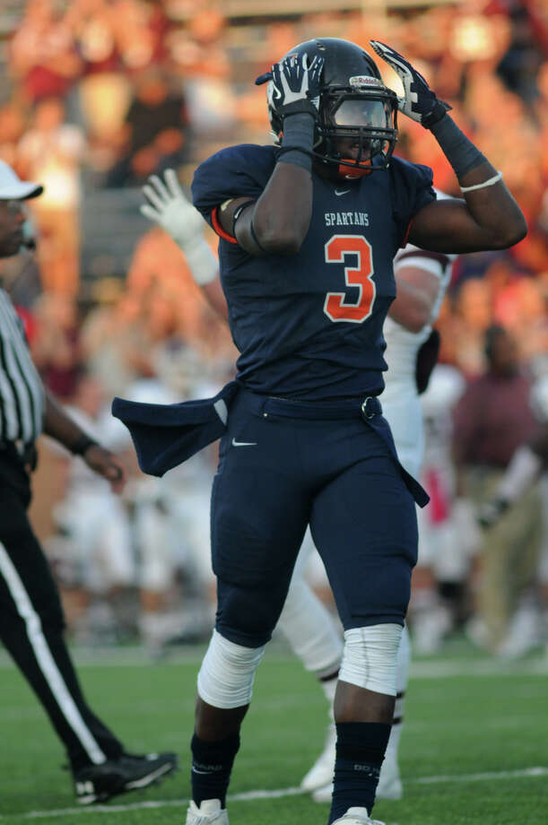Seven Lakes senior defensive back Bright Ugwoegbu expresses his surprise at the call of touchdown on Cinco Ranch's Denzell Bates carry late in the first quarter of their district matchup at Rhodes Stadium in Katy on Saturday. Photo: Jerry Baker, For The Chronicle