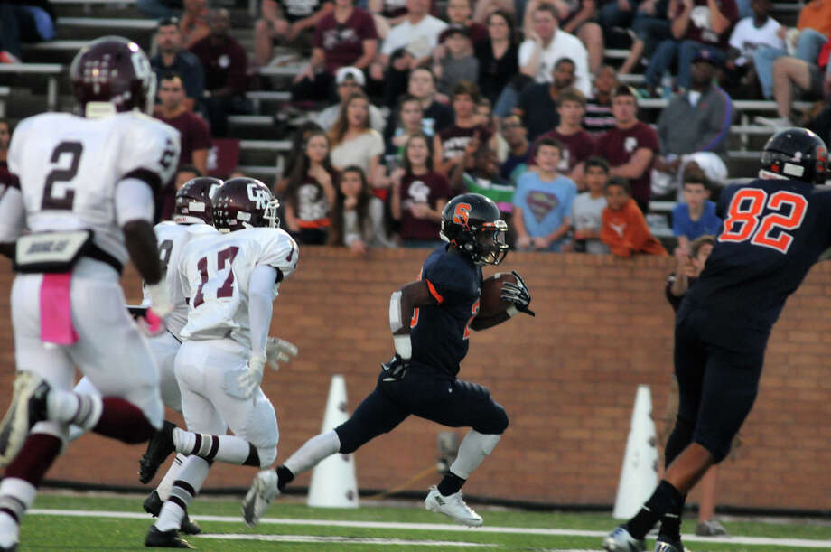 Seven Lakes junior running back Braeden West, center, runs for the end zone against the Cinco Ranch defense in second quarter action of their district matchup at Rhodes Stadium in Katy on Saturday. Photo: Jerry Baker, For The Chronicle