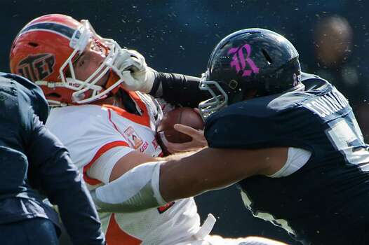 UTEP quarterback Blaire Sullivan (10) is hit by Rice defensive tackle Christian Covington (56) during the first half of a college football game at Rice Stadium, Saturday, Oct. 26, 2013, in Houston. Photo: Smiley N. Pool, Houston Chronicle / © 2013  Houston Chronicle