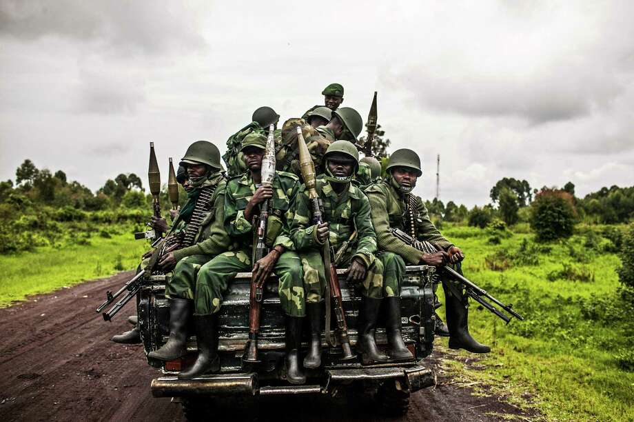 Congolese soldiers return from the front lines last month. The army has made a turnaround from its performance a year ago, when M23 rebels had the upper hand in fighting. Photo: New York Times File Photo