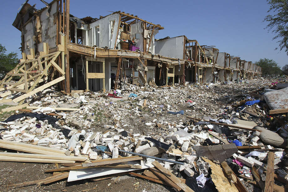 Debris litters the ground outside a destroyed apartment complex adjacent to the site of the April 24 fire and explosion in West. The explosion at West Fertilizer killed 14 people. Photo: Tom Reel / San Antonio Express-News