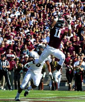 A&M's Derel Walker soars above Vanderbilt's Torren McGaster for the first of his two touchdown receptions Saturday. Photo: Cody Duty, Staff / © 2013 Houston Chronicle