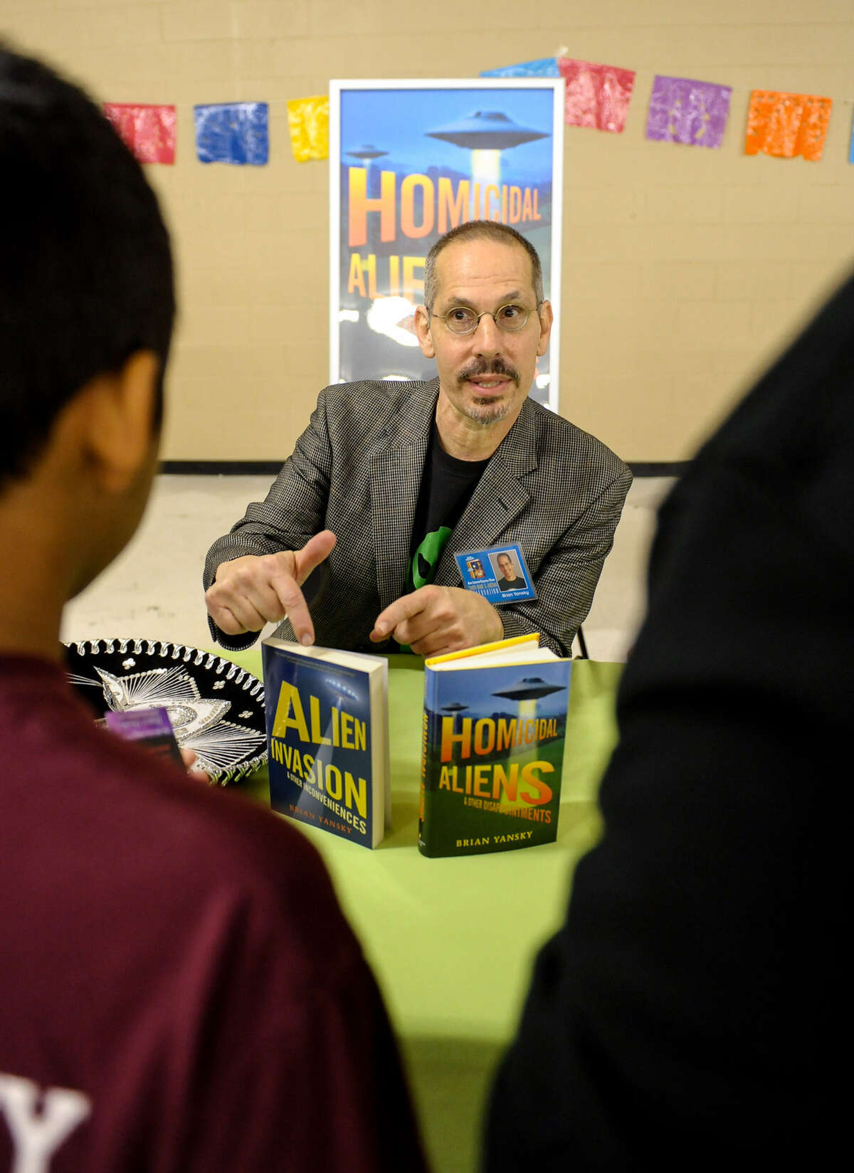 Author Brian Yansky talks with children at the San Antonio Express-News' 10th annual Youth Book & Author Celebration at the TriPoint YMCA.
