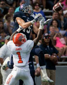 Rice receiver Jordan Taylor gave UTEP defensive backs like Adrian James fits. Photo: Smiley N. Pool, Staff / © 2013  Houston Chronicle
