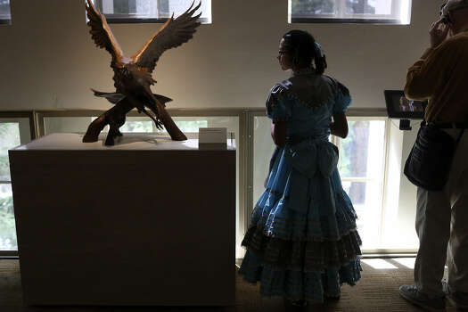 Caterina Parafina, 12, a member of the Las Espuelas Escaramuza Team, tours the Briscoe Western Art Museum after performing Saturday during the museum's grand opening celebration in downtown San Antonio. Photo: Photos By Lisa Krantz / San Antonio Express-News