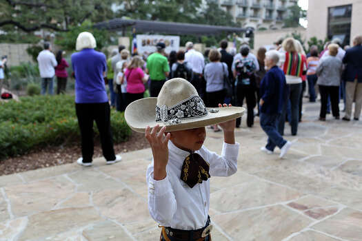 Diego Rivera, 8, entertains himself during the grand opening celebration for the Briscoe Western Art Museum in San Antonio on Saturday, Oct. 26, 2013. Photo: San Antonio Express-News / San Antonio Express-News