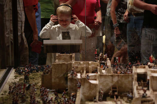 Bryar Crane, 5, of Lavernia, views the Battle of the Alamo display during the grand opening celebration for the Briscoe Western Art Museum in San Antonio on Saturday, Oct. 26, 2013. Photo: San Antonio Express-News / San Antonio Express-News