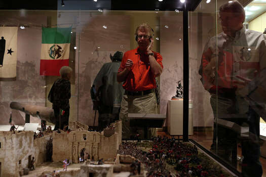 Harold Frank, of Washington, DC, views the Battle of the Alamo display during the grand opening celebration for the Briscoe Western Art Museum in San Antonio on Saturday, Oct. 26, 2013. Photo: San Antonio Express-News / San Antonio Express-News