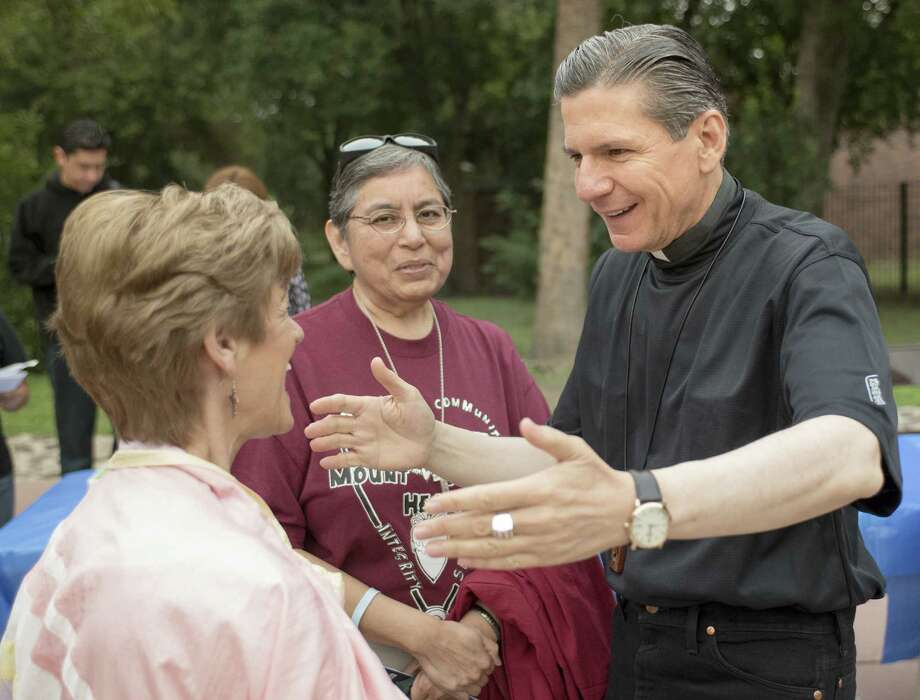 Gustavo García-Siller (right), the archbishop of San Antonio, greets Trudy Brink (left) and Sister Cecilia Rodriguez before embarking on a pilgrimage at Mission Concepcíon. Photo: Darren Abate / For The San Antonio Express-News