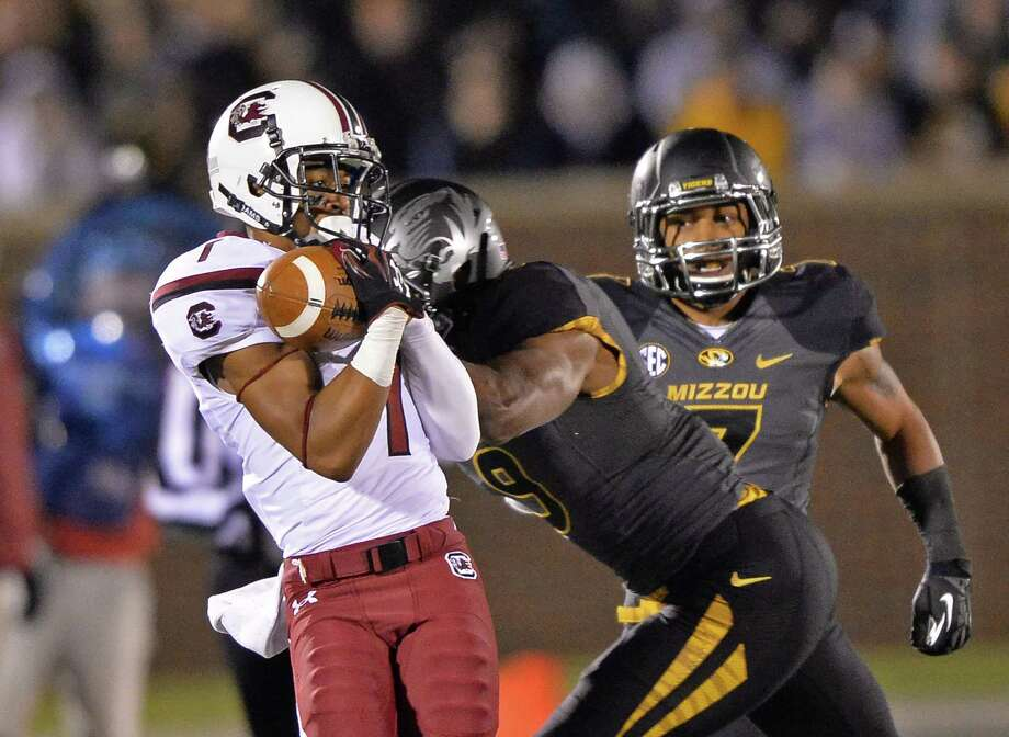 South Carolina running back Shon Carson makes a catch against Missouri safety Braylon Webb. Photo: Peter Aiken, Stringer / 2013 Getty Images