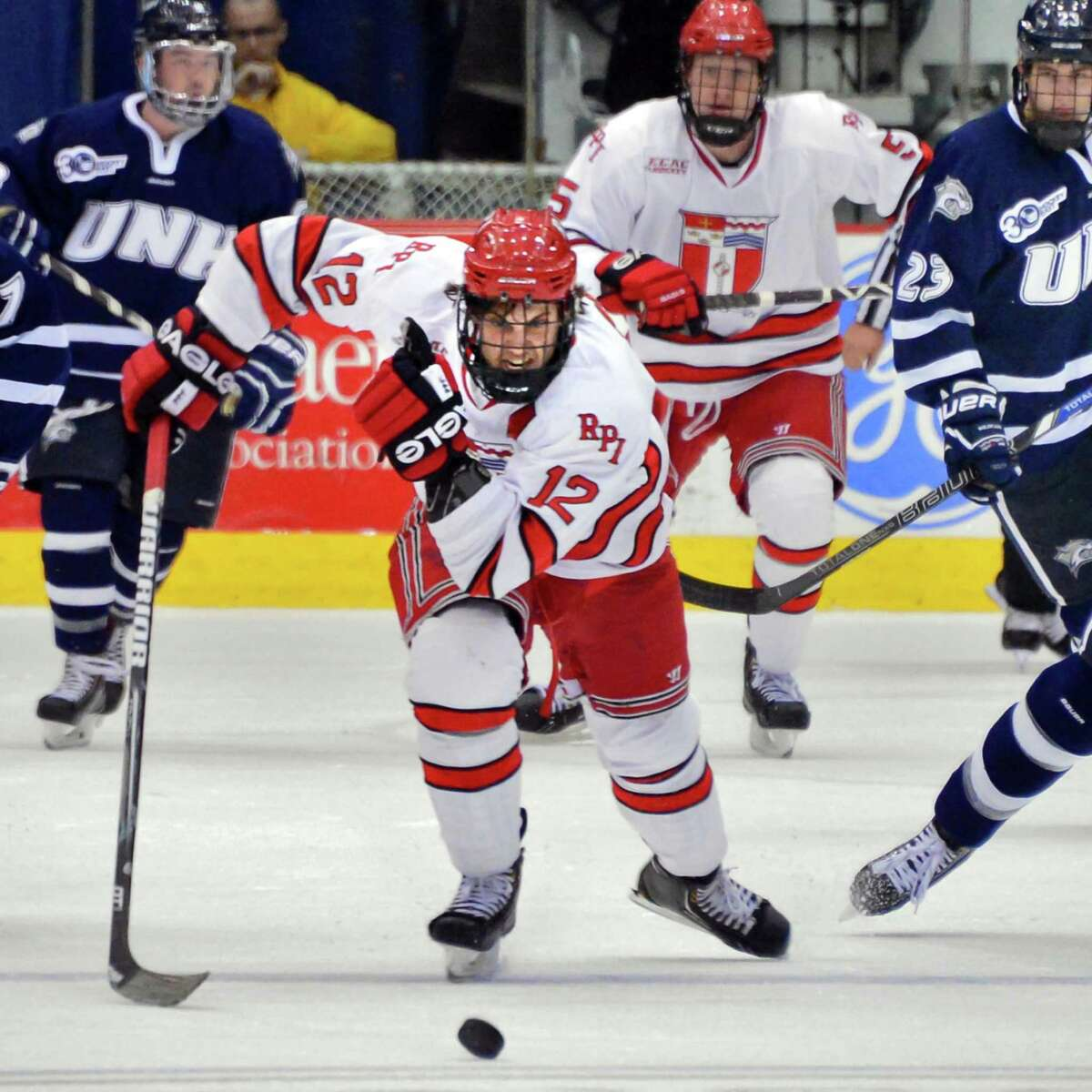 RPI's #12 Johnny Rogic brings the puck down through New Hampshire defenders at the Houston Field House Saturday Oct. 26, 2013, in Troy, NY. (John Carl D'Annibale / Times Union)