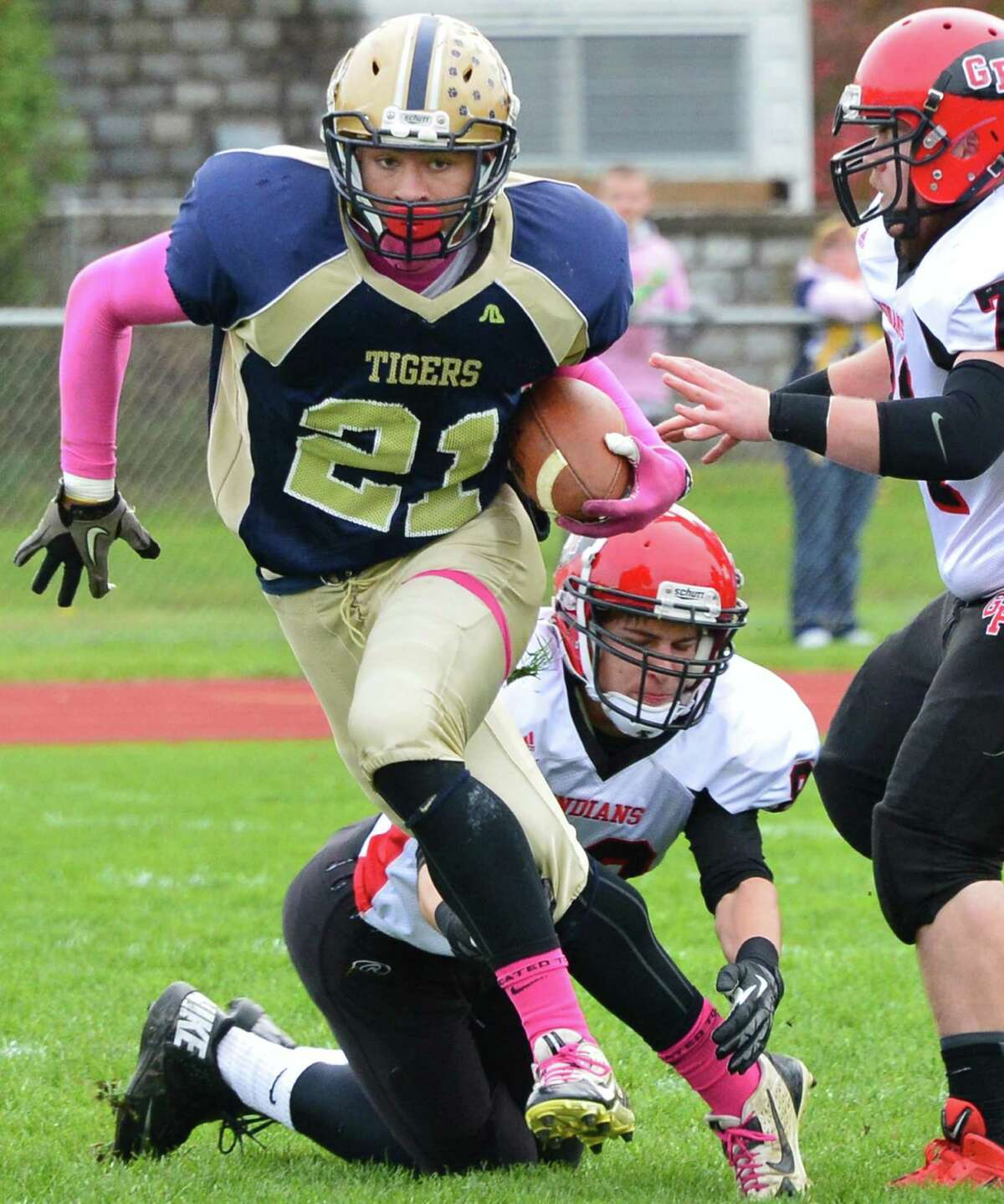 Cohoes' #21 Shelton Alston breaks away from Glens Falls' defenders during the Class B quarterfinal game Saturday Oct. 26, 2013, in Cohoes, NY. (John Carl D'Annibale / Times Union)
