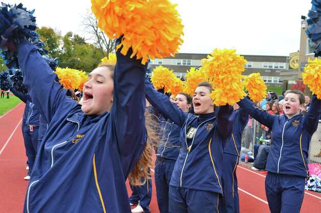 Cohoes' cheerleaders react as their team scores during the Class B quarterfinal game against Glens Falls Saturday Oct. 26, 2013, in Cohoes, NY.  (John Carl D'Annibale / Times Union) Photo: John Carl D'Annibale / 00024385A