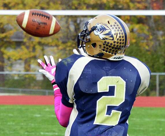 Cohoes' #2 Brandon Laforest reels in an over the shoulder pass to score during the Class B quarterfinal game against Glens Falls Saturday Oct. 26, 2013, in Cohoes, NY.  (John Carl D'Annibale / Times Union) Photo: John Carl D'Annibale / 00024385A
