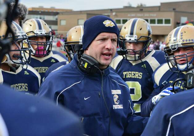 Cohoes' head coach James Ducharme, center, with players during  the Class B quarterfinal game against Glens Falls Saturday Oct. 26, 2013, in Cohoes, NY.  (John Carl D'Annibale / Times Union) Photo: John Carl D'Annibale / 00024385A