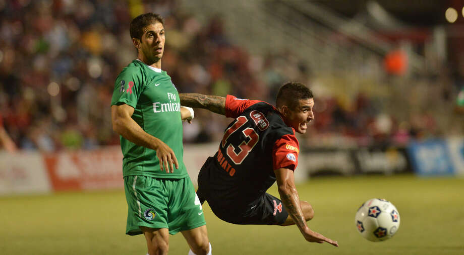 The Scorpions' Borja Rubiato (13) duels with the Cosmos' Carlos Mendes during Saturday's game at Toyota Field. The Cosmos will face Atlanta on Nov. 9 for the NASL title. Photo: Robin Jerstad / For The Express-News
