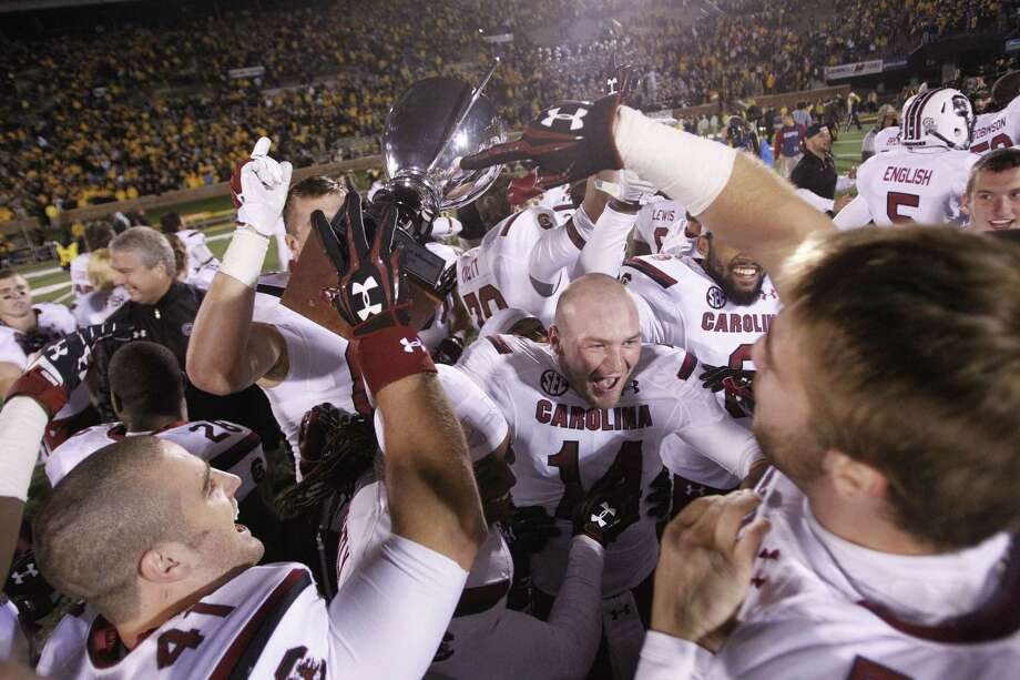 South Carolina celebrates its double-overtime victory over No.5 Missouri at Faurot Field in Columbia, Mo. Photo: Gerry Melendez / McClatchy-Tribune News Service