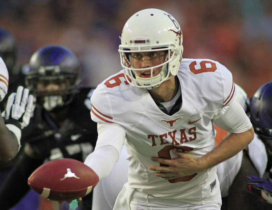 Texas quarterback Case McCoy hands the ball off in the first quarter against Texas Christian at Amon Carter Stadium in Fort Worth, Texas, on Saturday, October 26, 2013. (Paul Moseley/Fort Worth Star-Telegram/MCT) Photo: Paul Moseley, McClatchy-Tribune News Service / Fort Worth Star-Telegram