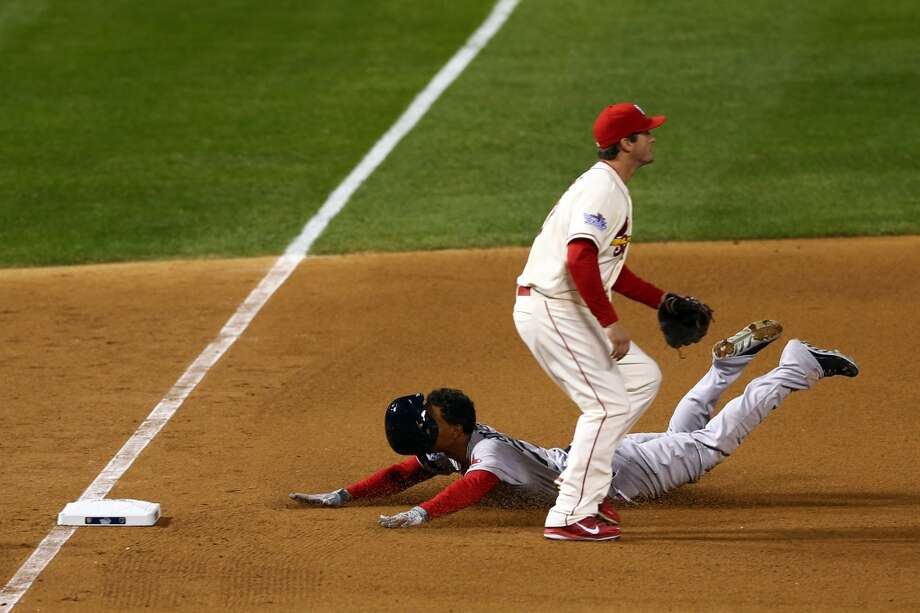Game 3: Cardinals 5, Red Sox 4Cardinals lead best-of-seven series 2-1Xander Bogaerts #72 of the Boston Red Sox slides into third past David Freese #23 of the St. Louis Cardinals after hitting a tripple in the fifth inning of Game Three of the 2013 World Series at Busch Stadium on October 26, 2013 in St Louis, Missouri.  (Photo by Elsa/Getty Images) Photo: Elsa, Getty Images