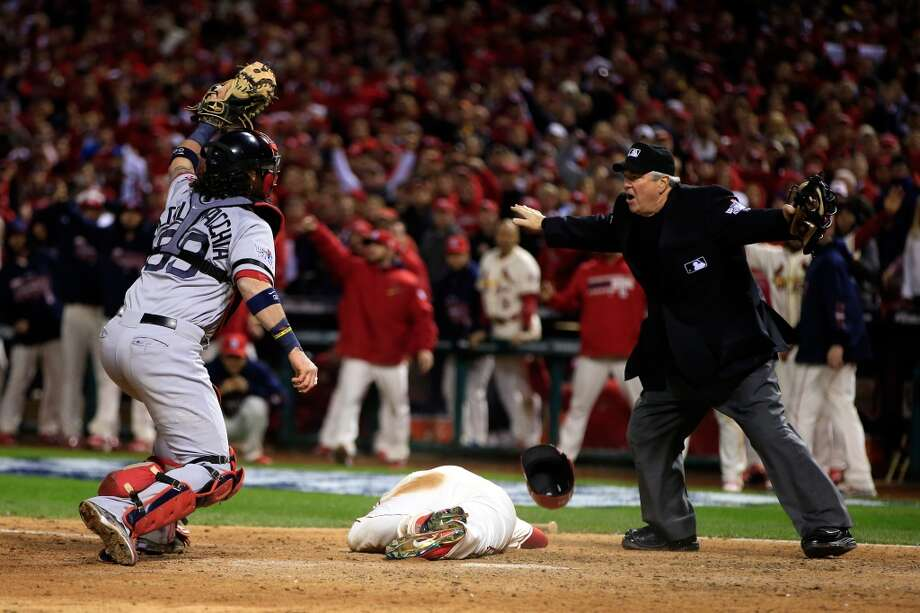 Allen Craig #21 of the Cardinals scores on a feilder's choice by Jon Jay in the ninth inning. Photo: Jamie Squire, Getty Images