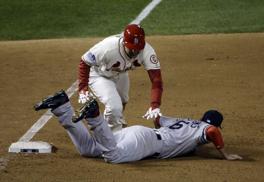 Allen Craig gets tangled with Will Middlebrooks during the ninth inning. Photo: David J. Phillip, Associated Press