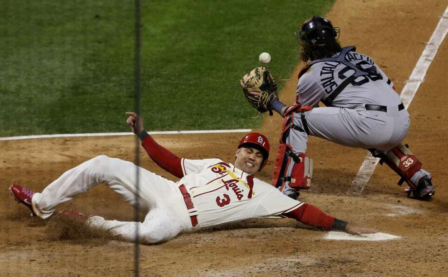 Carlos Beltran (3) of the Cardinals is safe at home on a triple by Matt Holliday in the seventh inning. Photo: J.B. Forbes, McClatchy-Tribune News Service