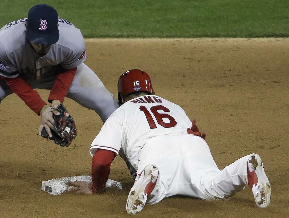 Kolten Wong steals second with Xander Bogaerts covering. Photo: David J. Phillip, Associated Press