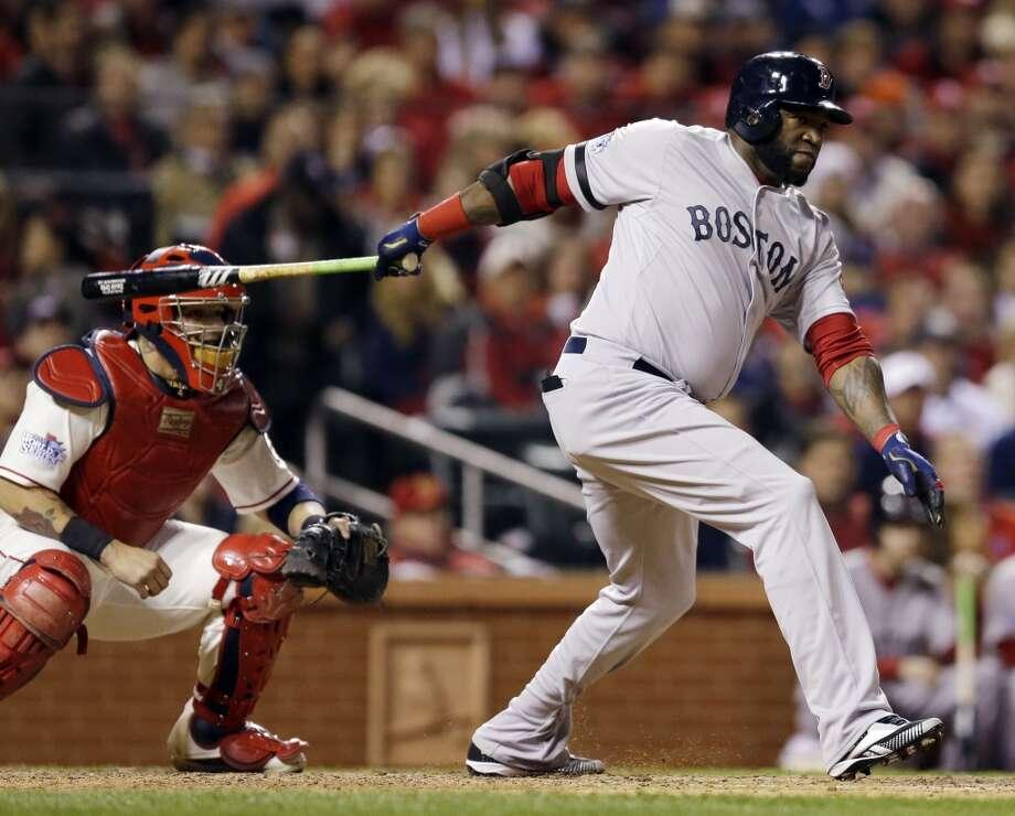 David Ortiz hits a single during the sixth inning. Photo: Jeff Roberson, Associated Press