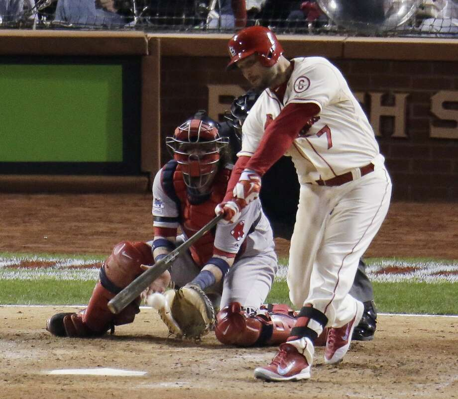 Matt Holliday hits a two-run scoring double during the seventh inning. Photo: Charlie Riedel, Associated Press