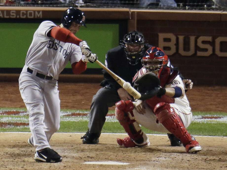 Daniel Nava hits an RBI single during the sixth inning. Photo: Charlie Riedel, Associated Press