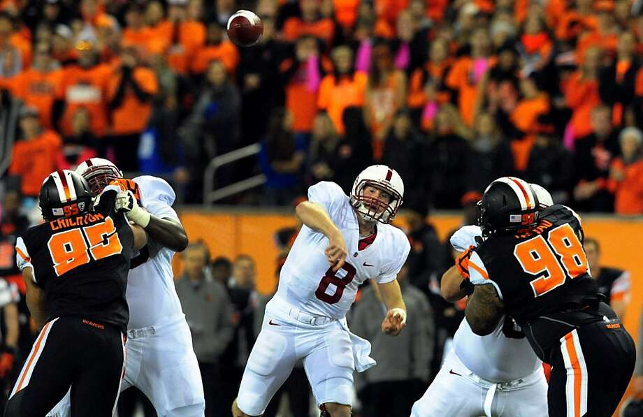 Stanford quarterback Kevin Hogan throws the ball downfield in the first quarter of the Cardinal's 20-12 victory over Oregon State. Photo: Steve Dykes, Getty Images