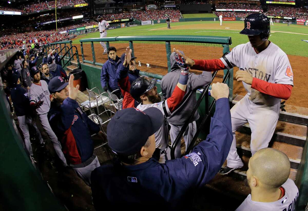 Boston Red Sox's Xander Bogaerts is congratulated after scoring during the fifth inning of Game 3 of baseball's World Series against the St. Louis Cardinals Saturday, Oct. 26, 2013, in St. Louis. (AP Photo/Matt Slocum) ORG XMIT: WS551