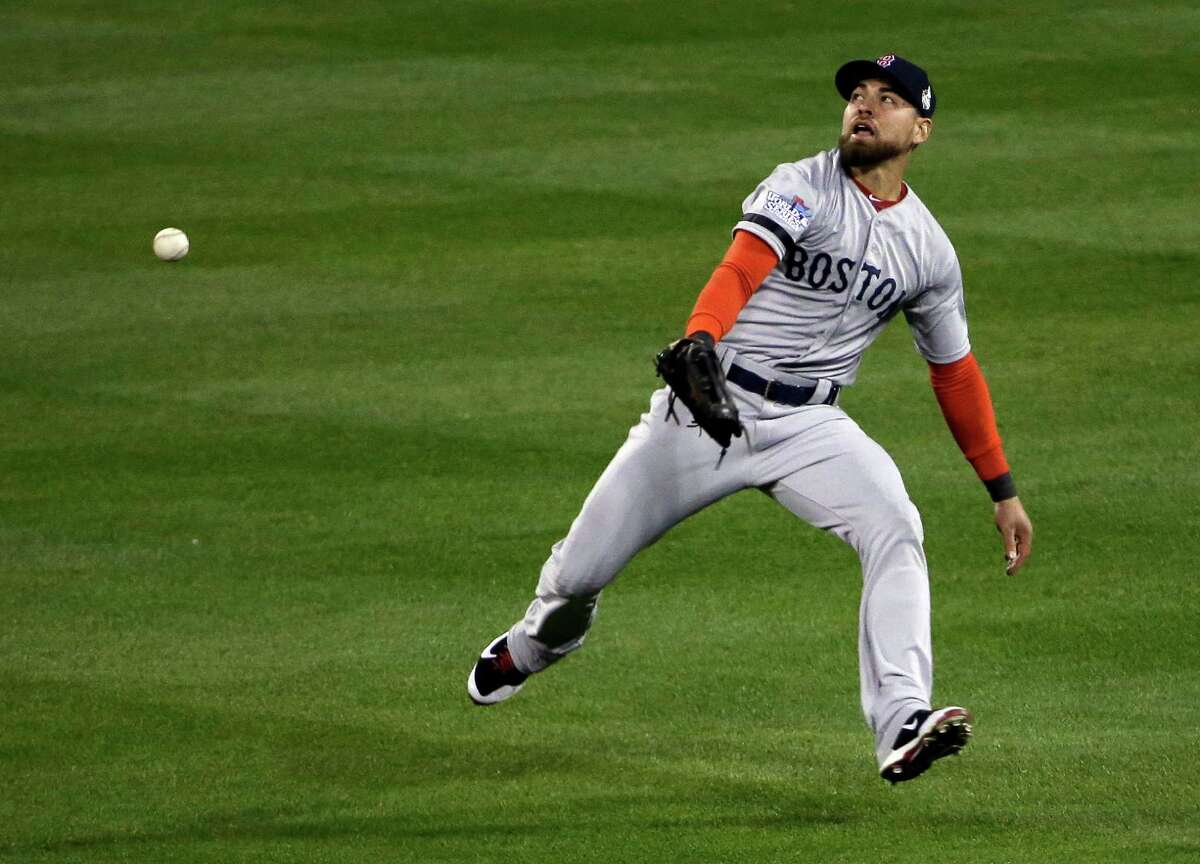 Boston Red Sox's Jacoby Ellsbury can't catch a ball hit by St. Louis Cardinals' Matt Holliday during the third inning of Game 3 of baseball's World Series Saturday, Oct. 26, 2013, in St. Louis. (AP Photo/David J. Phillip) ORG XMIT: WS170