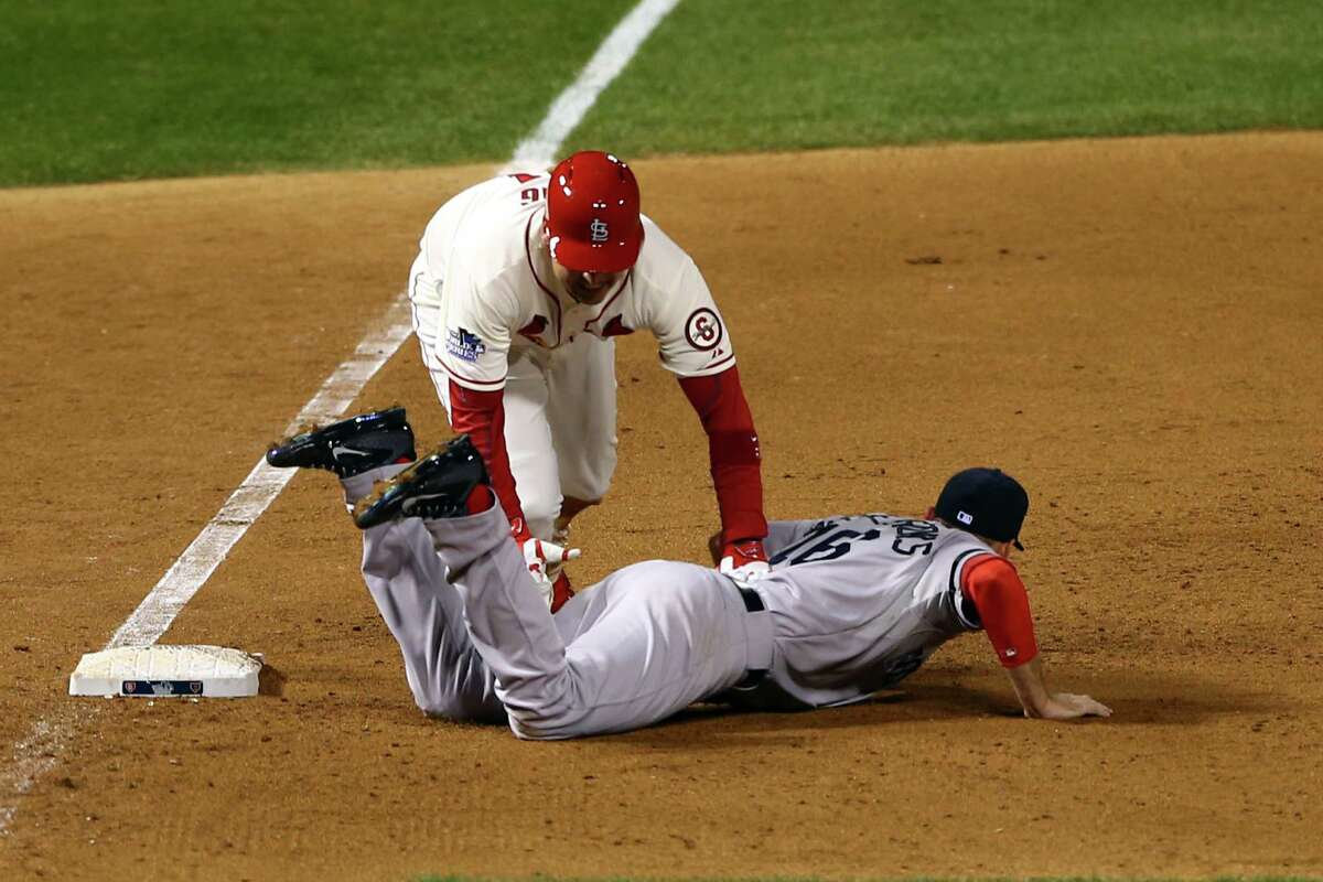 ST LOUIS, MO - OCTOBER 26: Allen Craig #21 of the St. Louis Cardinals gets tripped up by Will Middlebrooks #16 of the Boston Red Sox during the ninth inning of Game Three of the 2013 World Series at Busch Stadium on October 26, 2013 in St Louis, Missouri. (Photo by Elsa/Getty Images) ORG XMIT: 185688288