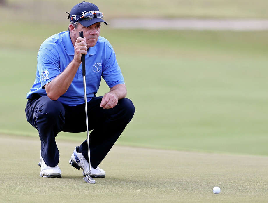 Scott Dunlap lines up a putt on No. 16 during the second round of the AT&T Championship held Saturday Oct. 26, 2013 on the AT&T Canyons Course at TPC San Antonio. Photo: Edward A. Ornelas, San Antonio Express-News / © 2013 San Antonio Express-News