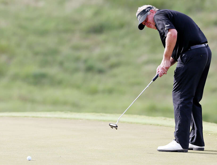 Colin Montgomerie putts on No. 16 during the second round of the AT&T Championship held Saturday Oct. 26, 2013 on the AT&T Canyons Course at TPC San Antonio. Photo: Edward A. Ornelas, San Antonio Express-News / © 2013 San Antonio Express-News
