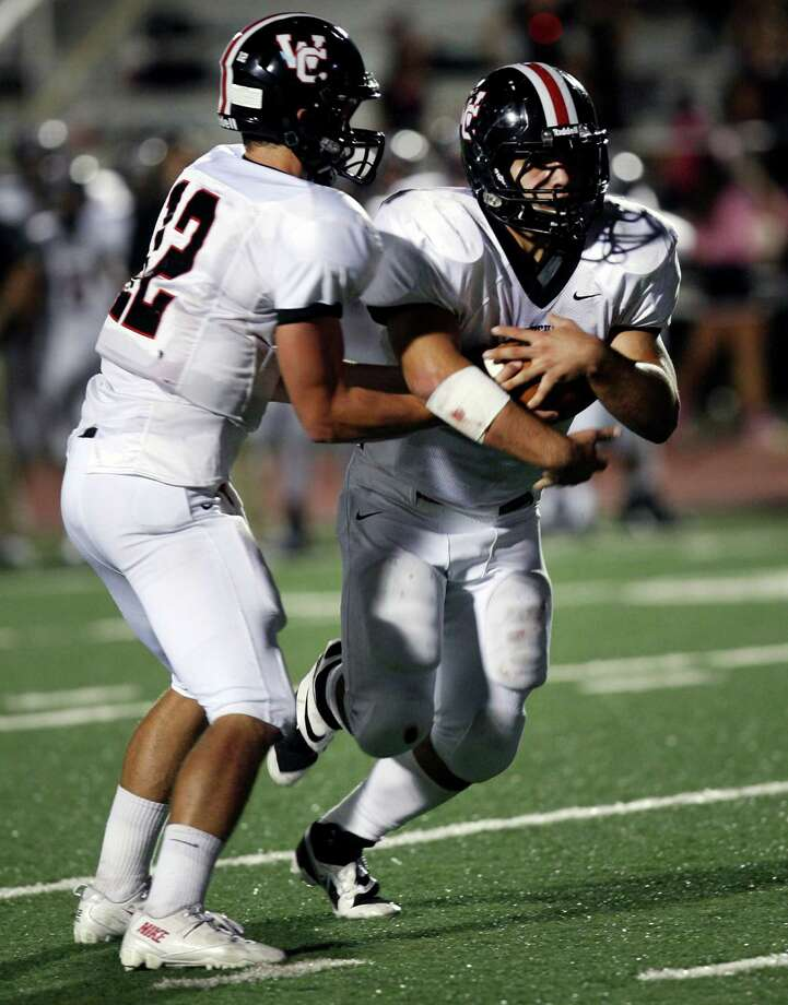 Churchill High School's Nate Peason passes off the ball to Nicholas Smisek during the first half of the game against Roosevelt Saturday, Oct. 26, 2013 at Comalander Stadium. Photo: Cynthia Esparza, F / For the San Antonio Express-News