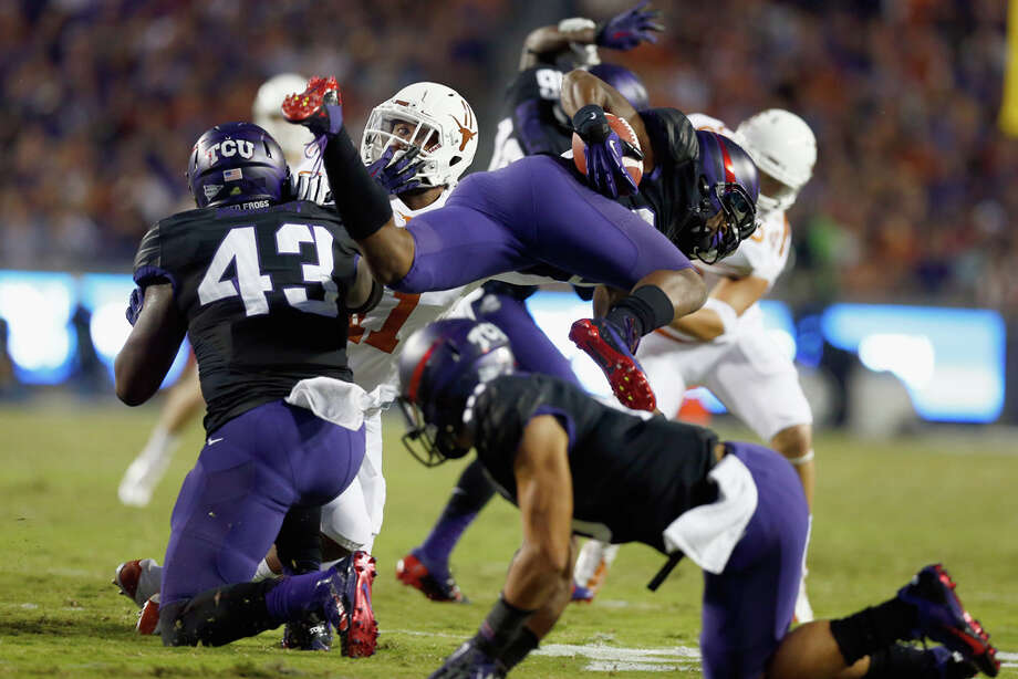 FORT WORTH, TX - OCTOBER 26:  Deante' Gray #20 of the TCU Horned Frogs gets tripped up while returning a punt against the Texas Longhorns in the first quarter at Amon G. Carter Stadium on October 26, 2013 in Fort Worth, Texas. Photo: Tom Pennington, Getty Images / 2013 Getty Images