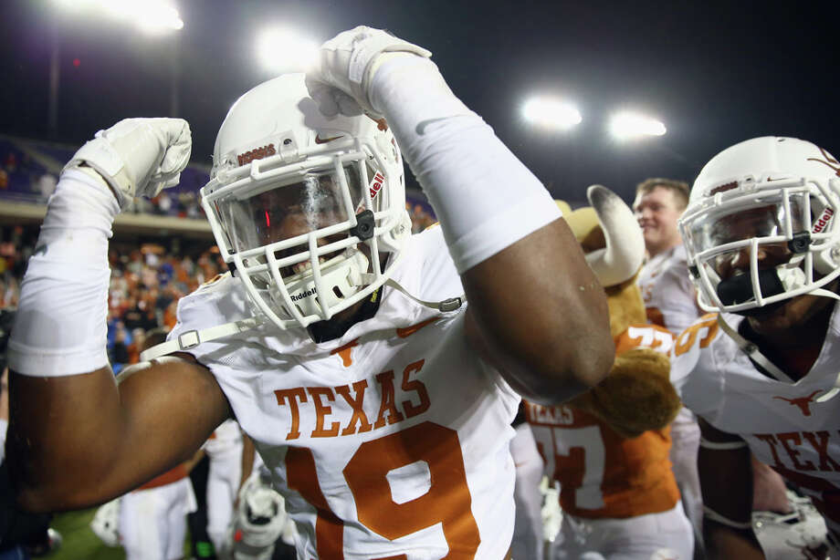 FORT WORTH, TX - OCTOBER 27:  Peter Jinkens #19 of the Texas Longhorns celebrates after the Longhorns beat the TCU Horned Frogs 30-7 at Amon G. Carter Stadium on October 27, 2013 in Fort Worth, Texas. Photo: Tom Pennington, Getty Images / 2013 Getty Images