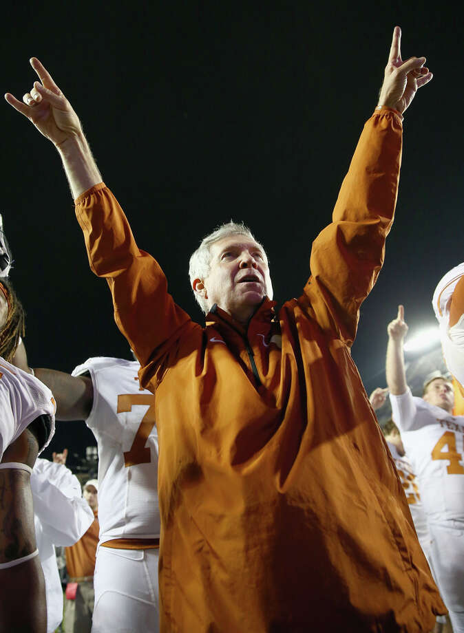 FORT WORTH, TX - OCTOBER 27:  Head coach Mack Brown of the Texas Longhorns celebrates after the Longhorns beat the TCU Horned Frogs 30-7 at Amon G. Carter Stadium on October 27, 2013 in Fort Worth, Texas. Photo: Tom Pennington, Getty Images / 2013 Getty Images
