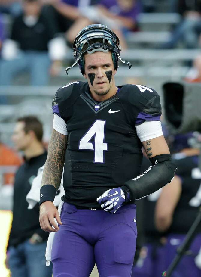 TCU quarterback Casey Pachall (4) walks the field as he warms up before an NCAA college football game against Texas Saturday, Oct. 26, 2013, in Fort Worth, Texas. (AP Photo/LM Otero) Photo: LM Otero, Associated Press / AP