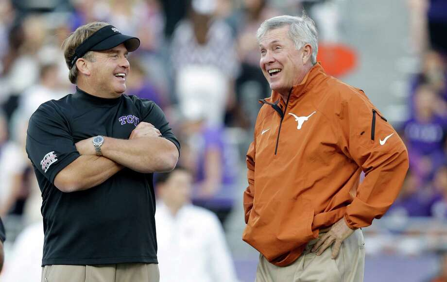TCU head coach Gary Patterson, left, laughs with Texas head coach Mack Brown, right, during team warmups before an NCAA college football game on Saturday, Oct. 26, 2013, in Fort Worth, Texas. (AP Photo/LM Otero) Photo: LM Otero, Associated Press / AP