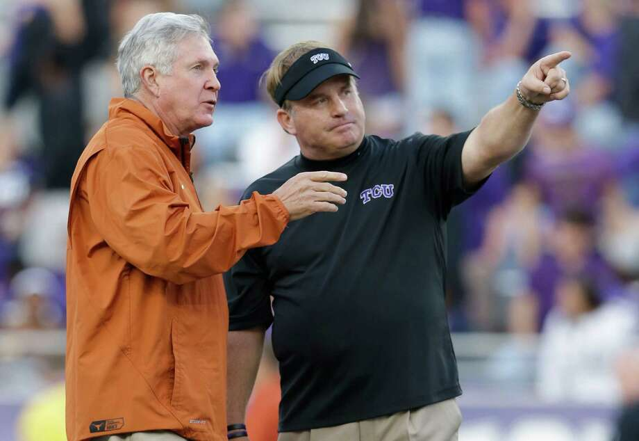 TCU head coach Gary Patterson, right, talks with Texas head coach Mack Brown on the field during team warm-ups before an NCAA college football game Saturday, Oct. 26, 2013, in Fort Worth, Texas. (AP Photo/LM Otero) Photo: LM Otero, Associated Press / AP