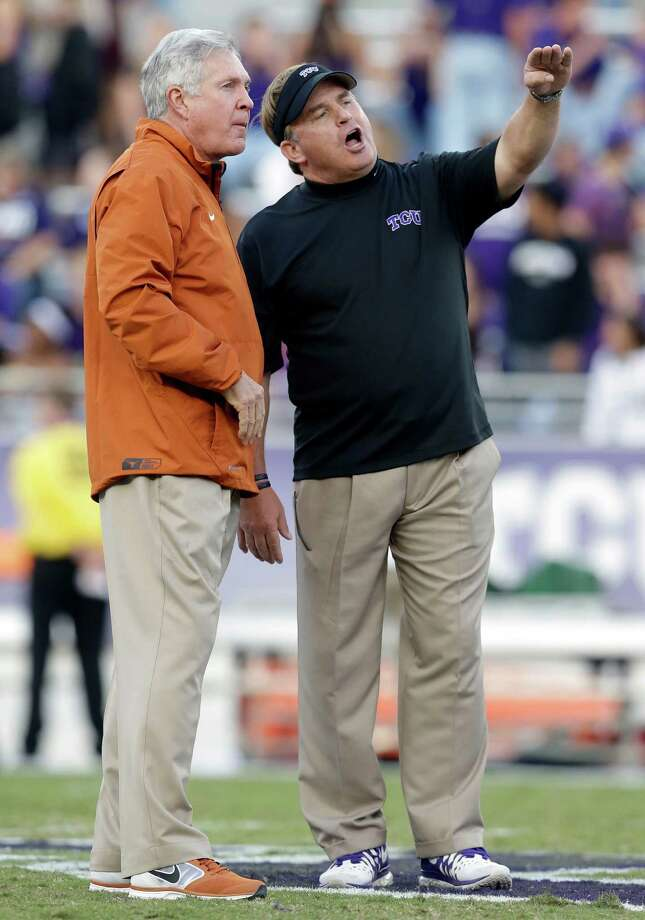TCU head coach Gary Patterson, right, talks with Texas head coach Mack Brown, left, on the field during team warmups before an NCAA college football game on Saturday, Oct. 26, 2013, in Fort Worth, Texas. (AP Photo/LM Otero) Photo: LM Otero, Associated Press / AP
