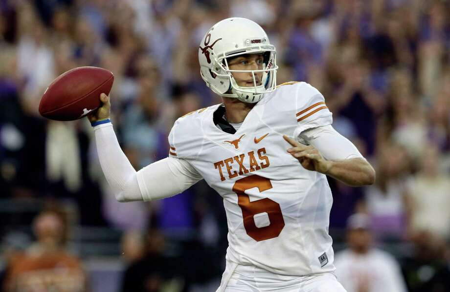 Texas quarterback Case McCoy (6)  passes during the first half of an NCAA college football game against TCU, Saturday, Oct. 26, 2013, in Fort Worth, Texas. (AP Photo/LM Otero) Photo: LM Otero, Associated Press / AP