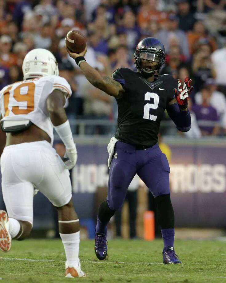 TCU quarterback Trevone Boykin (2) passes under pressure from Texas linebacker Peter Jinkens (19) during the first half of an NCAA college football game on Saturday, Oct. 26, 2013, in Fort Worth, Texas. (AP Photo/LM Otero) Photo: LM Otero, Associated Press / AP